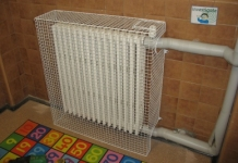 MS Guardio supplies bespoke wire mesh radiator guards for all kinds of radiators including those with pipes and switches, with obstructions and in awkward spaces